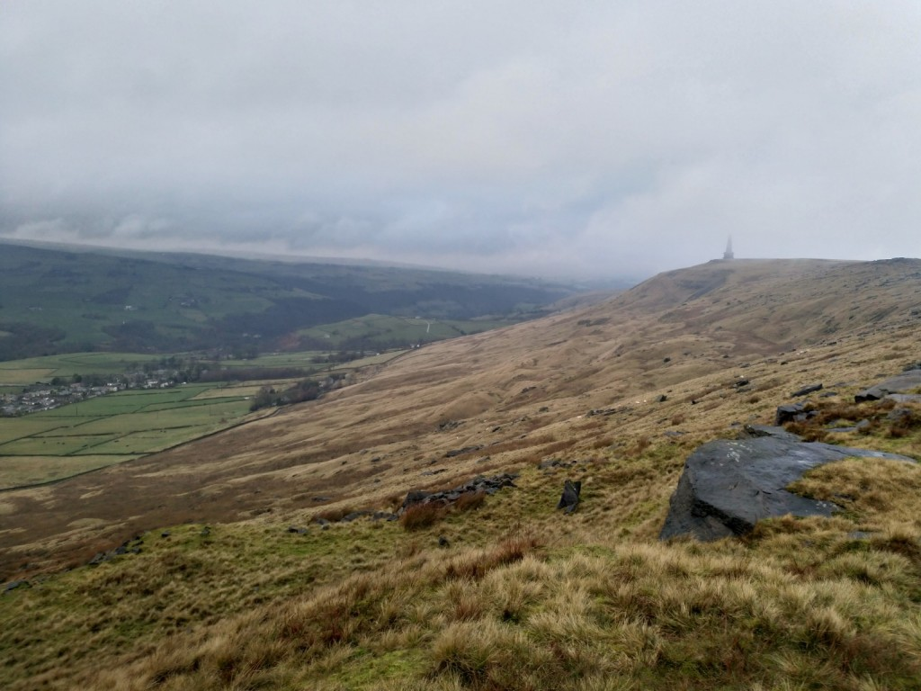 Stoodley Pike monument is in the distance of this image where millstone