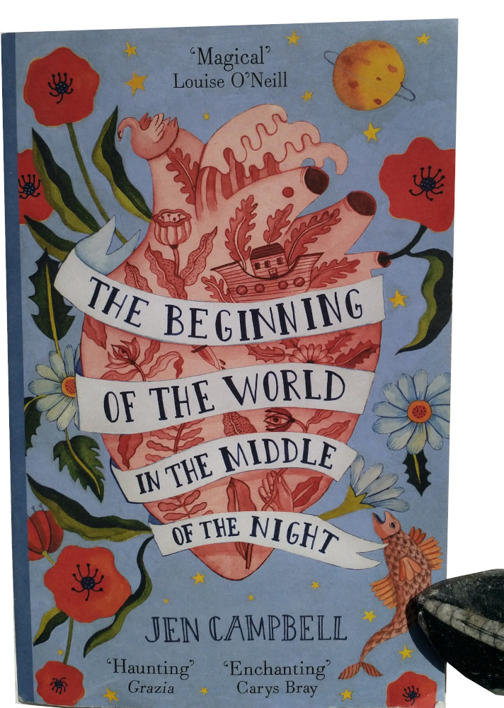 An image of Jen Campbell's novel 'The Beginning of the World in the Middle of the Night' and a fossilised leaf next to it.